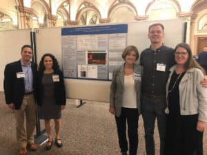 Presentation of our Drug Repurposing projects poster by the Mission: Cure team