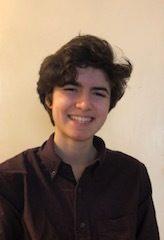 J Adelman smiling