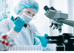 medical professional pipetting liquid into a petri dish